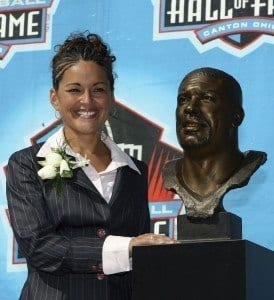 CANTON, OH - AUGUST 05: Sara White, wife of the late Reggie White, poses with his bust after his induction during the Class of 2006 Pro Football Hall of Fame Enshrinement Ceremony at Fawcett Stadium on August 5, 2006 in Canton, Ohio. (Photo by Doug Benc/Getty Images)
