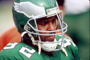 WASHINGTON, DC - SEPTEMBER 7: Defensive lineman Reggie White #92 of the Philadelphia Eagles looks on from the sideline during a game against the Washington Redskins at RFK Stadium on September 7, 1986 in Washington, DC. The Redskins defeated the Eagles 41-14. (Photo by George Gojkovich/Getty Images)