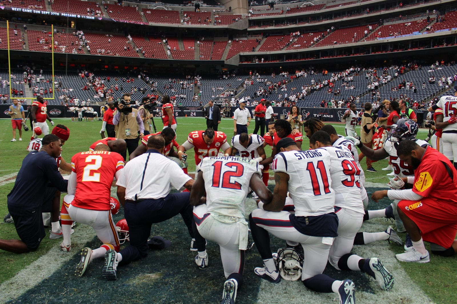 NFL: Several players kneel for anthem, some teams stay in ...
