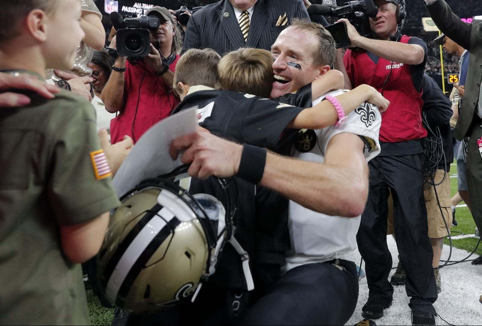New Orleans Saints quarterback Drew Brees (9) hugs his family after  breaking the NFL all-time passing record in the first half of an NFL  football game ... 73c24437f